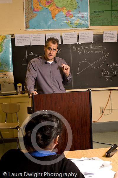 Education High School mathematics class male teacher talking t class vertical