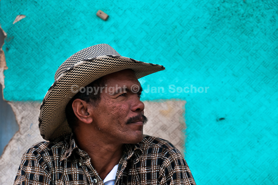 A displaced Colombian cowboy (vaquero) from Caquetá department sits in front of his house in the slum of Ciudad Bolívar, Bogota, 30 May 2010.