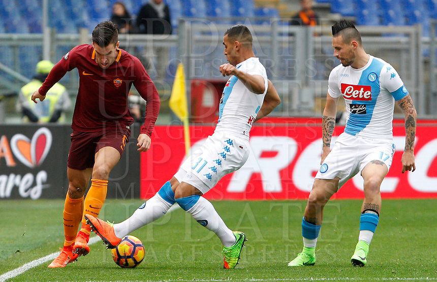 Roma's Kevin Strootman, right, is challenged by Napoli's Faouzi Ghoulam, center, and Marek Hamsik, during the Italian Serie A football match between Roma and Napoli at Rome's Olympic stadium, 4 March 2017. <br /> UPDATE IMAGES PRESS/Riccardo De Luca