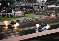 Jun. 17, 2011; Bristol, TN, USA: NHRA funny car driver Ron Capps (left) alongside Robert Hight during qualifying for the Thunder Valley Nationals at Bristol Dragway. Mandatory Credit: Mark J. Rebilas-
