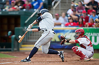 Lane Adams (8) of the Northwest Arkansas Naturals makes contact on a pitch during a game against the Springfield Cardinals at Hammons Field on July 28, 2013 in Springfield, Missouri. (David Welker/Four Seam Images)