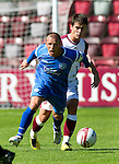 Hearts v St Johnstone...14.08.10  .Jody Morris is fouled by Ian Black.Picture by Graeme Hart..Copyright Perthshire Picture Agency.Tel: 01738 623350  Mobile: 07990 594431