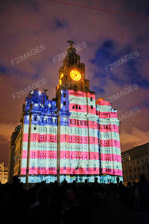 Cunard Line's Three Queens Meeting Liverpool. 24.5.15. The American flag is displayed on the Liver Building as part of the projection  'Sea of Faces'