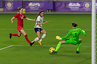 ORLANDO CITY, FL - FEBRUARY 18: Christen Press #23 takes a shot saved by Stephanie Labbé #1 while pressured by Gabrielle Carle #14 during a game between Canada and USWNT at Exploria stadium on February 18, 2021 in Orlando City, Florida.