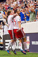 Brandon Barklage (25) of the New York Red Bulls celebrates scoring with Dax McCarty (11). The New York Red Bulls defeated DC United 3-2 during a Major League Soccer (MLS) match at Red Bull Arena in Harrison, NJ, on June 24, 2012.