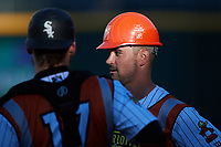 Matt Reynolds (1) of the Charlotte Traffic Cones wears a hard hat prior to the game against the Norfolk Tides at Truist Field on August 20, 2021 in Charlotte, North Carolina. (Brian Westerholt/Four Seam Images)