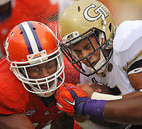 Clemson's Travis Blanks and Georgia Tech quarterback Justin Thomas collide in the rain during a game in Clemson.(Travis Bell/SIDELINE CAROLINA)