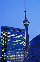 Canada, Ontario, Toronto, CN Tower and office building illuminated at dusk