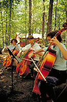 summer students practicing cellos under the trees at the internationally famous Interlochen Center for the Arts, music. Interlochen Michigan USA.