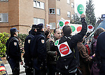Riot police stop  anti-eviction activisst  during an 'escrache'  outside popular party deputy and defense comission spokeswoman Beatriz Rodriguez-Salmones house in Madrid on April 11, 2013 in Madrid, Spain. Placard reads ' Yes we can but they don't want'. The Mortgage Holders Platform (PAH) and other anti evictions organizations have been organizing 'escraches' for several weeks under the slogan 'There are lives at risk' to claim the vote for a Popular Legislative Initiative (ILP) to stop evictions and facilitate social rent, outside Popular Party deputies' houses and offices. 'Escraches' are a form of peaceful protest that were used in Argentine in 1995 to publically denounce pardoned members of the dictatorship for their crimes at their doorsteps(ALTERPHOTOS/Alconada)