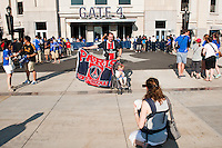 A Paris Saint-Germain fan poses for a photo in front of Yankee Stadium prior to the match between Chelsea FC and Paris Saint-Germain during the 2012 Herbalife World Football Challenge at Yankee Stadium in New York, NY, on July 22, 2012.