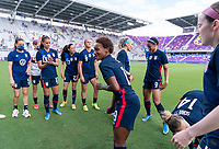 ORLANDO, FL - FEBRUARY 21: Crystal Dunn #19 of the USWNT dances in the huddle before a game between Brazil and USWNT at Exploria Stadium on February 21, 2021 in Orlando, Florida.
