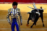 A Spanish bullfighter runs away from a bull at the bullring in Torremolinos, Spain, 28 July 2006.