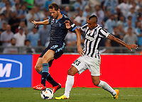 Calcio, Supercoppa di Lega: Juventus vs Lazio. Roma, stadio Olimpico, 18 agosto 2013<br /> Lazio midfielder Senad Lulic, of Bosnia, right, is challenged by Juventus midfielder Arturo Vidal, of Chile, during the Italian League Supercup football final match between Juventus and Lazio, at Rome's Olympic stadium,  18 August 2013.<br /> UPDATE IMAGES PRESS/Riccardo De Luca