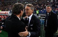 Calcio, Serie A: Roma vs Inter. Roma, stadio Olimpico, 30 novembre 2014.<br /> Roma's coach Rudi Garcia, left, and  Roberto Mancini shake hands prior to the start of the Italian Serie A football match between AS Roma and FC Inter at Rome's Olympic stadium, 30 November 2014.<br /> UPDATE IMAGES PRESS/Riccardo De Luca