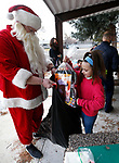Heroes from the Carson City Sheriff's Office and Carson City Fire Department meet with students at Fritsch Elementary School in Carson City, Nev., on Tuesday, Dec. 15, 2020. The school hosted an event for their Holiday with a Hero gift recipients. <br /> Photo by Cathleen Allison