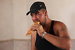 DOMIZ, IRAQ: A Syrian refugee eats bread inside a mosque in the Domiz refugee camp where he is living...Over 7,000 Syrian Kurds have fled the violence in Syria and are living in the Domiz refugee camp in the semi-autonomous region of Iraqi Kurdistan...Photo by Ari Jalal/Metrography