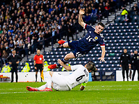 9th October 2021; Hampden Park, Glasgow, Scotland; FIFA World Cup football qualification, Scotland versus Israel; Billy Gilmour goes down over the tackle from Natcho of Israel