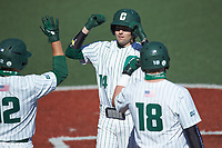 Austin Knight (14) Charlotte 49ers is greeted at home plate by teammates Aaron McKeithan (12) and Will Butcher (18) after hitting a home run against the Florida Atlantic Owls at Hayes Stadium on April 2, 2021 in Charlotte, North Carolina. The 49ers defeated the Owls 9-5. (Brian Westerholt/Four Seam Images)