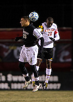 Chris Odio-Atsem (28) of Maryland goes up for a header with Wilder Arboleda (20) of Providence during the second round of the NCAA tournament at Ludwig Field in College Park, MD.  Maryland defeated Providence, 3-1.