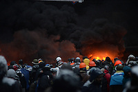 Rioters throw stones and molotov cocktails during the   protest against new draconian law to ban the right to  protest across the country.  Kiev. Ukraine