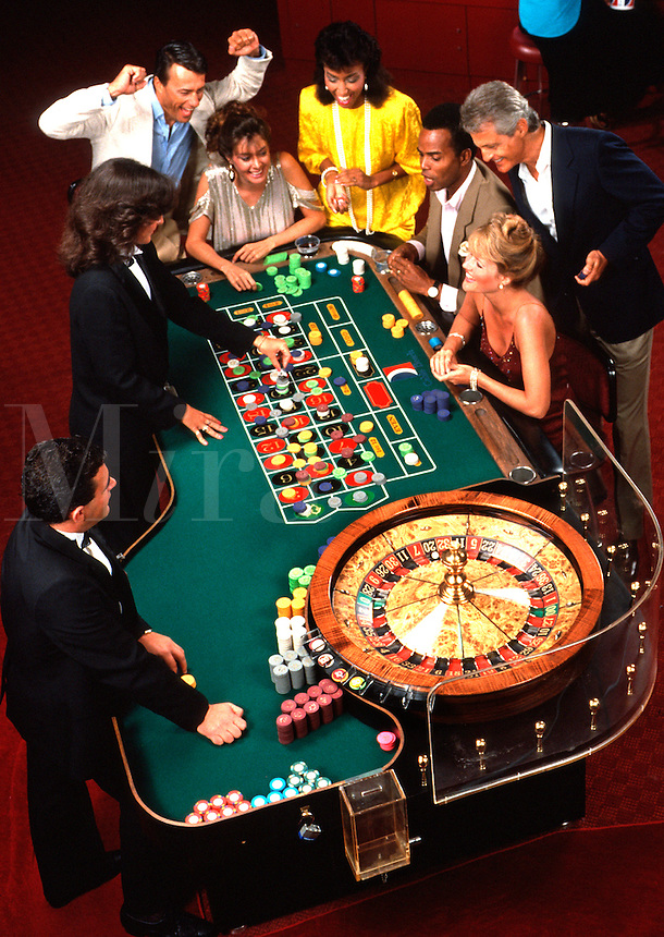 Mixed ethnic couples at roulette table, Caribbean