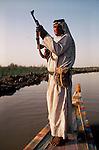 Marsh Arabs. Southern Iraq. Marsh Arab man with rifle. Haur al Mamar or Haur al-Hamar marsh collectively known now as Hammar marshes Iraq 1984
