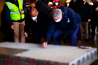 NEW YORK, NEW YORK- FEBRUARY 22, 2021: (L-R) Queens Borough President Donovan Richards and New York City Mayor Bill De Blasio sign concrete placement while delivering remarks at topping off ceremony for a 100 percent affordable housing project in the downtown section of Far Rockaway, Queens on February 22, 2021 in New York City.   Photo Credit: mpi43/MediaPunch