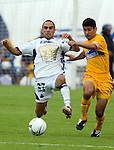 UNAM Pumas striker Fernando Morales (L) fights for the ball with UANL'sTigres defender Javier Saavedra during their soccer match at the University Stadium in Mexico City, April 23, 2006. UNAM tied 1-1 to UANL.  Photo by © Javier Rodriguez..
