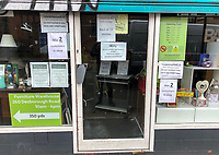 a charity shop shows signage relating to coronavirus & limiting to 2 customer at any one time within the shop in the town centre on March 19, 2020 in High Wycombe, United Kingdom during the COVID-19 pandemic causing people to panic buy items. Photo by Andy Rowland.