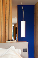 A blue sliding door strikes a signature note of colour in this contemporary bedroom