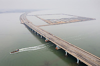 A fishing boat travels under the Suhe Bridge, near the megacity of Tianjin in north-east China. Major infrastructure that supports the daily functioning of the city is often the first impacted as storm surges hit and sea levels rise. The city also has problems with land subsidence which exacerbates the problems faced. 2019