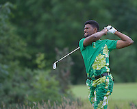 23.06.2014.  Ash, Kent, England. The Open Golf Regional Qualifier played on the International Course at The London Golf Course. Monday Eze (A) [Nigeria] hacks out of the rough.