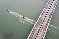 Fishing boats travel under the Suhe Bridge, near the megacity of Tianjin in north-east China. Major infrastructure that supports the daily functioning of the city is often the first impacted as storm surges hit and sea levels rise. The city also has problems with land subsidence which exacerbates the problems faced. 2019