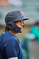 Dillon Thomas (20) of the Tacoma Rainiers waits to bat against the Salt Lake Bees at Smith's Ballpark on May 13, 2021 in Salt Lake City, Utah. The Rainiers defeated the Bees 15-5. (Stephen Smith/Four Seam Images)