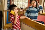 Education Preschool 3-4 year olds pretend play two boys talking on telephones horizontal