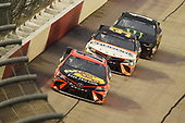 DARLINGTON, SOUTH CAROLINA - MAY 20: Martin Truex Jr., driver of the #19 Bass Pro Shops Toyota, leads a pack of cars during the NASCAR Cup Series Toyota 500 at Darlington Raceway on May 20, 2020 in Darlington, South Carolina. (Photo by Jared C. Tilton/Getty Images)