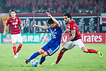 Suwon Defender Jang Hoik (L) fights for the ball with Guangzhou Forward Ricardo Goulart (R) during the AFC Champions League 2017 Group G match between Guangzhou Evergrande FC (CHN) vs Suwon Samsung Bluewings (KOR) at the Tianhe Stadium on 09 May 2017 in Guangzhou, China. Photo by Yu Chun Christopher Wong / Power Sport Images
