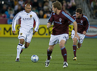 Real Salt Lake midfielder Robbie Russell (white) dribbles aside Colorado's Colin Clark.. Real Salt Lake earned a tied versus the Colorado Rapids securing a place in the postseason. Dick's Sporting Goods Park, Denver, Colorado, October, 25, 2008. Photo by Trent Davol/isiphotos.com