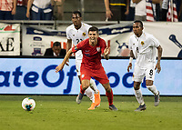 KANSAS CITY, KS - JUNE 26: Christian Pulisic #10 moves to the ball during a game between Panama and USMNT at Children's Mercy Park on June 26, 2019 in Kansas City, Kansas.