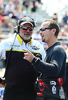 Sept. 22, 2012; Ennis, TX, USA: NHRA funny car driver Jack Beckman (right) talks with NHRA starter Mark Lyle during qualifying for the Fall Nationals at the Texas Motorplex. Mandatory Credit: Mark J. Rebilas-US PRESSWIRE