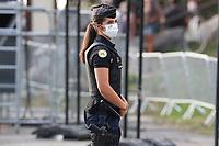 15th September 2020; Lyon, France; Tour De France 2020, La Tour-du-Pin to Villard-de-Lans, stage 16; A police woman wearing a mask keeps an eye on proceedings