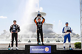 #2: Josef Newgarden, Team Penske Chevrolet, #5: Pato O'Ward, Arrow McLaren SP Chevrolet, #10: Alex Palou, Chip Ganassi Racing Honda, podium