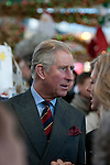 Prince Charles meeting traders and shoppers during his visit to Swansea Market in South Wales this afternoon.