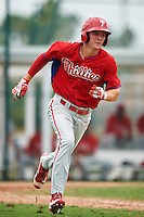 GCL Phillies center fielder Mickey Moniak (15) runs to first base after hitting a double down the line during a game against the GCL Pirates on August 6, 2016 at Pirate City in Bradenton, Florida.  GCL Phillies defeated the GCL Pirates 4-1.  (Mike Janes/Four Seam Images)