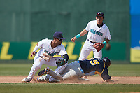 Jacob Wetzel (55) of the Myrtle Beach Pelicans steals second base ahead of the tag by Lynchburg Hillcats shortstop Yordys Valdes (7) at Bank of the James Stadium on May 23, 2021 in Lynchburg, Virginia. (Brian Westerholt/Four Seam Images)