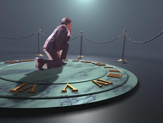 Business man on sundial