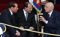 Il Presidente della Repubblica Giorgio Napolitano, a destra, parla col Presidente del Consiglio Silvio Berlusconi, sinistra, e col Presidente del Senato Renato Schifani durante la parata militare per la Festa della Repubblica a Roma, 2 giugno 2008. .Italy's Head of State Giorgio Napolitano, right, talks to the Italian Premier Silvio Berlusconi, left, and Senate speaker Renato Schifani during the military parade for the Italian Republic Day in Rome, 2 june 2008. UPDATE IMAGES PRESS/Riccardo De Luca