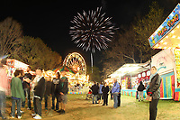 ALTERED STATE PHOTO ESSAY/ANDREW SHURTLEFF<br /> People stop to enjoy the annual Dogwood Festival fireworks in McIntire Park.<br /> <br /> Shut downs and stay-in-place orders, the most recent of which came from Gov. Ralph Northam Monday, have left Charlottesville dormant. Students have been sent home, many businesses have shut their doors and events have been canceled. In this photo essay, photographer Andrew Shurtleff has spent time capturing the effects of the pandemic and comparing the duality of the present with our social past.