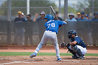 Los Angeles Dodgers outfielder Yunior Garcia (78) at bat in front of catcher Luis Avalo (97) during an Instructional League game against the Milwaukee Brewers at Maryvale Baseball Park on September 24, 2018 in Phoenix, Arizona. (Zachary Lucy/Four Seam Images)